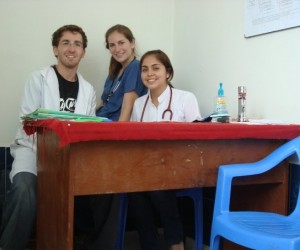 Jon (left) working at a clinic in Peru
